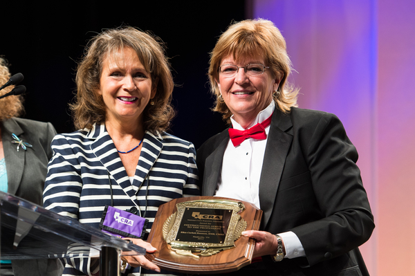 Ellie Corbett Hannum (left) receives NCRA's 2013 Distinguished Service Awardfrom NCRA Immediate Past President Tami Keenan (right).