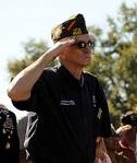 Veteran in uniform saluting