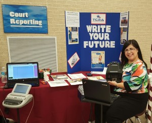 A court reporter shows off her steno machine at a career fair
