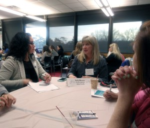 Kelly Moranz, CRI, Tri-C's court reporting program manager and an adjunct faculty member, talks to attendees during the speed networking session at the Tri-C open house