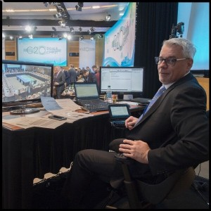 Patric Martin pauses for the camera while captioning the G-20 meeting