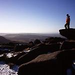 Hiker standing on rocky edge