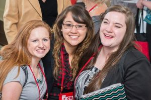 Three smiling female students at the NCRA Convention & Expo