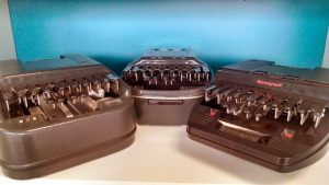 Three 1980s models of steno machines grouped together