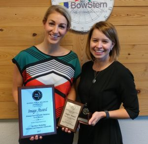 BowStern representatives Ashleigh Flanders and Amanda Handley hold three awards -- two plaques and a trophy