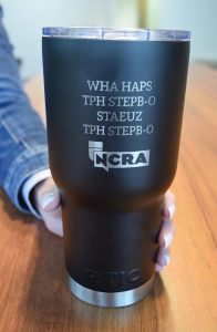Tumbler with NCRA logo and text: WHA HAPS TPH STEPB-O STAEUZ TPH STEPB-O