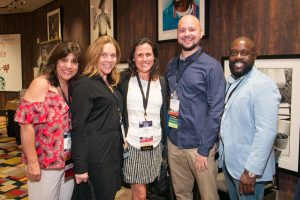 NCRA Convention & Expo attendees enjoy a moment catching up with friends