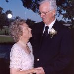 Photo of an NCRF Major Gifts donor: A husband and wife in formal dress -- as if for a wedding -- gaze at each other